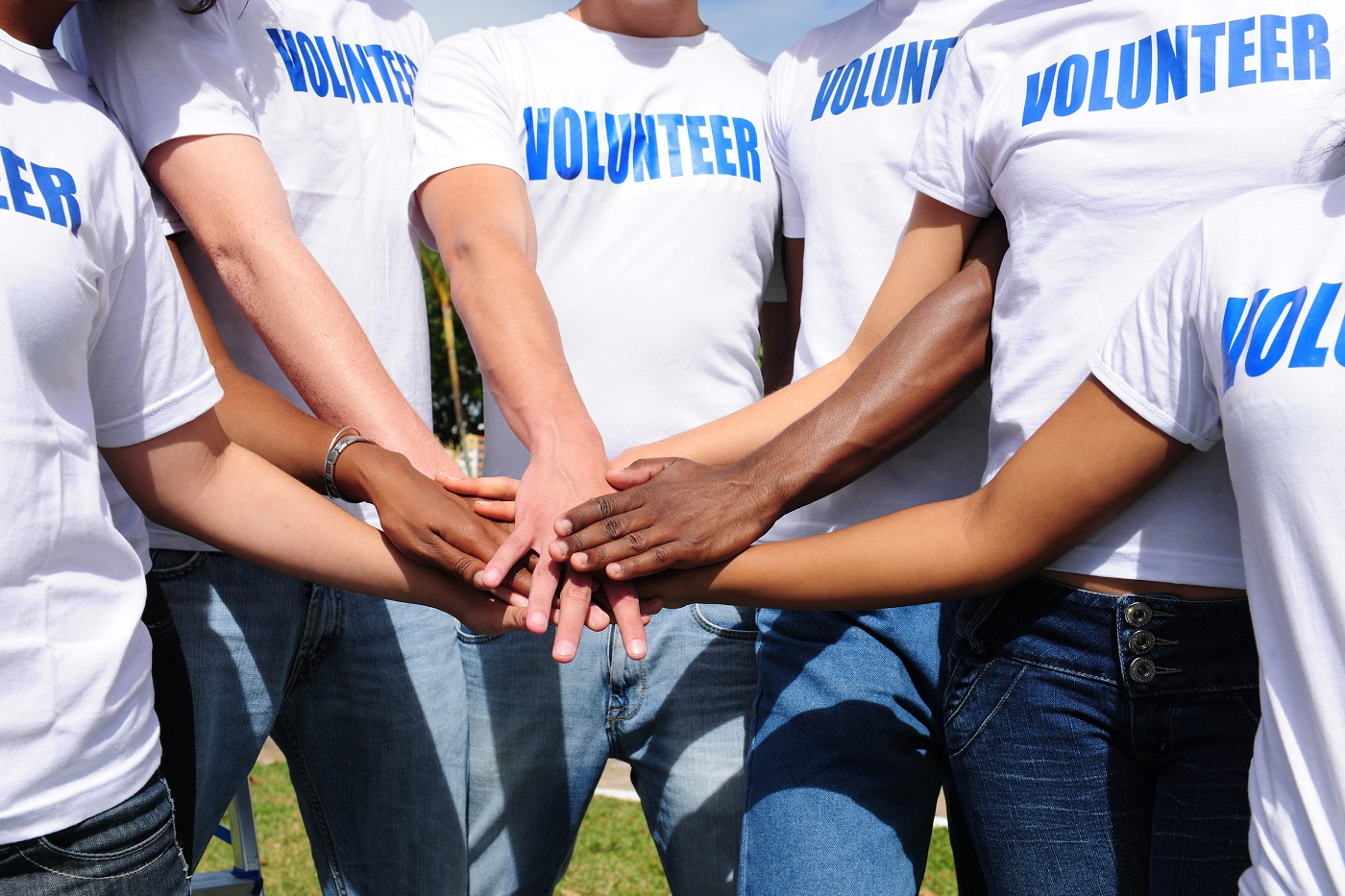 Go Volunteer group with hands together